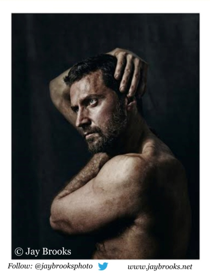Richard Armitage discovers his left ear. Image by Jay Brooks, 2014.