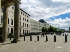 Columns of Brandenburg Gate with US Embassy stretching to the right